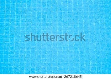 Refreshing blue pool water background - stock photo