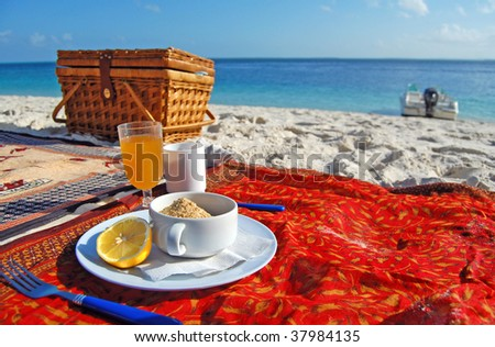 Refreshing breakfast on a tropical beach - stock photo