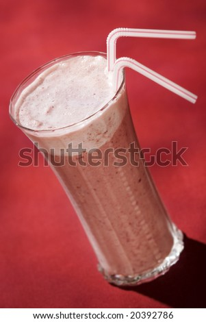 Refreshing cherry smoothie with two straws - stock photo
