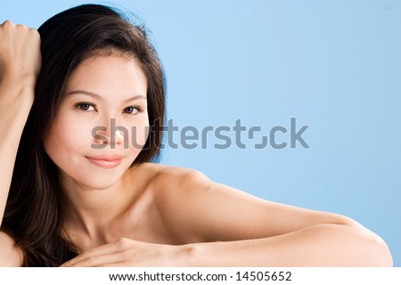 refreshing clean face of an asian mature woman smiling