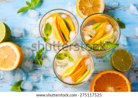 refreshing cold citrus water with mint.top view - stock photo