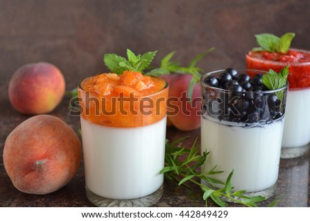 Refreshing cold  white yogurt  with aromatic summer fruits and berries - fresh apricot puree,  black currants,strawberry,peach, melissa leaves. Delicious  dessert. Healthy breakfast. - stock photo