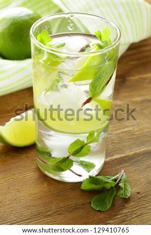 refreshing drink with lime and mint - Mojito - stock photo