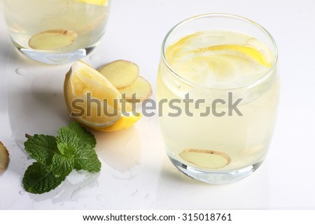 refreshing flavors of lemonade, ginger, and mint in a glass