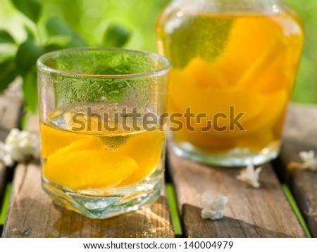 Refreshing fruit lemonade or white Sangria in glasses, selective focus - stock photo