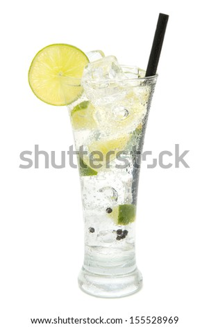 refreshing gin and tonic on white background - stock photo