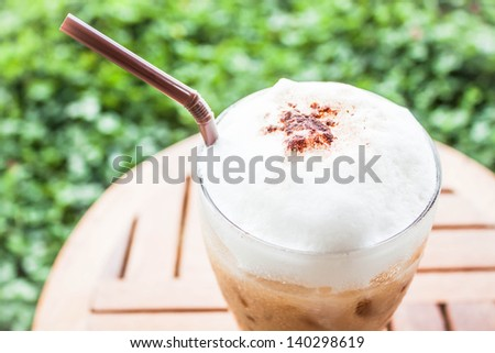 Refreshing glass of iced blended espresso with milk foam - stock photo