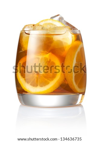 Refreshing glass of iced tea and lemon - stock photo
