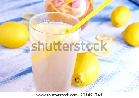 Refreshing Homemade Ice Cold Strawberry Lemonade with ginger and lemons - stock photo