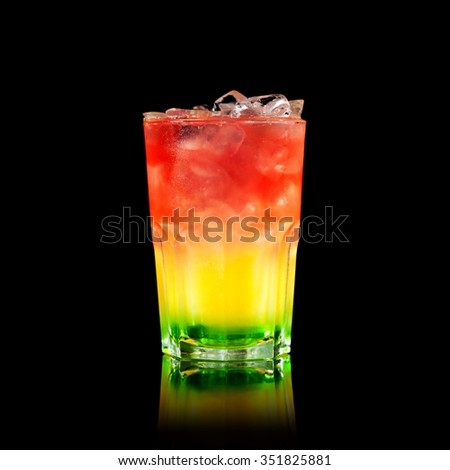 Refreshing ice cold cocktail on in a glass on a black background