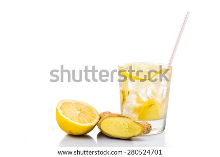 Refreshing ice cold ginger lemon tea in transparent glass