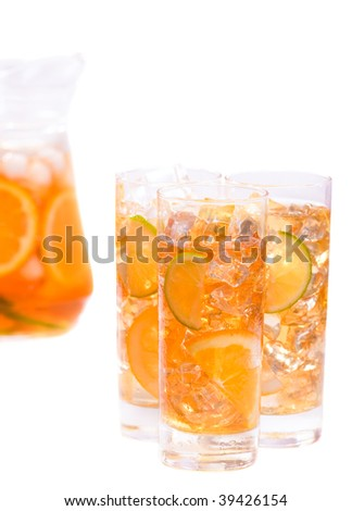 Refreshing ice drink. Three glasses of refreshing ice tee with citrus fruits - stock photo