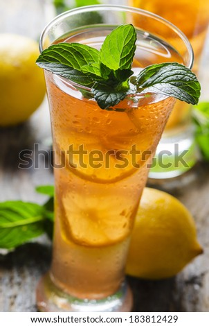 Refreshing ice tea with lemon and mint - stock photo