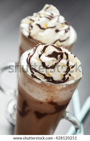 Refreshing iced coffee drink with whipped cream: freddoccino, frappuccino
