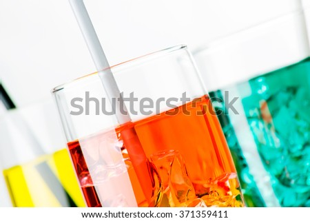 Refreshing iced drinks in transparent glasses closeup