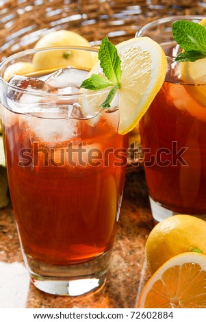 Refreshing iced tea makes a perfect drink on a hot summer day - stock photo