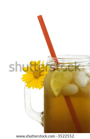 Refreshing iced tea with lemon wedge, served southern style in a jelly jar! - stock photo