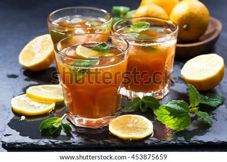 refreshing iced tea with mint and lemon, horizontal