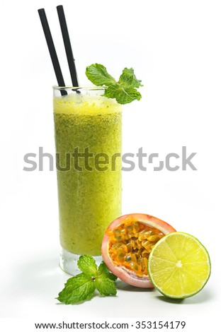 Refreshing passion fruit juice with mint and lime - stock photo
