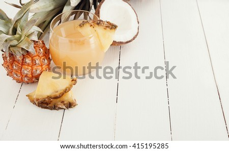 Refreshing pineapple juice on the table - stock photo