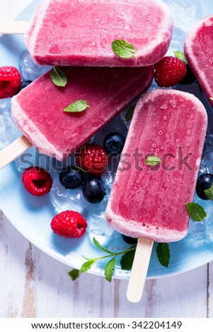 Refreshing popsicle with berry fruits, summer time - stock photo