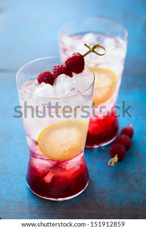 Refreshing Raspberry Drink in glasses - stock photo
