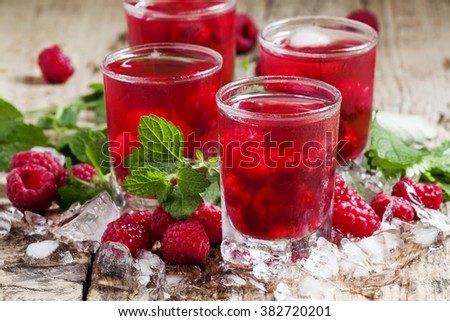 Refreshing raspberry drink with berries, ice and mint, selective focus - stock photo