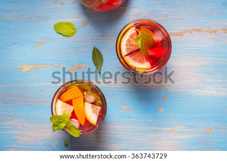 Refreshing summer cocktails with citrus fruits over blue vintage table. Top view. Selective focus - stock photo