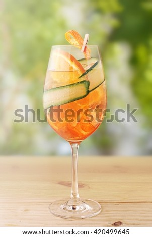 Refreshing summer drink Aperol spritz on table - stock photo