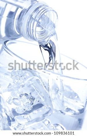 Refreshing water in a bottle against a background - stock photo