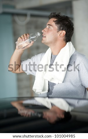 Refreshment after sport training - stock photo