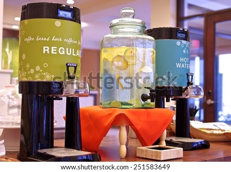 Refreshment Dispensers Coffee, hot water and lemon water displayed in colorful dispensers placed on a table - stock photo