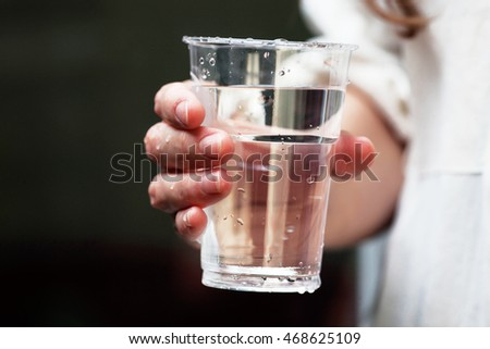 Refreshment pith a glass of water on a sunny, hot summer day. Water and thirst concept
