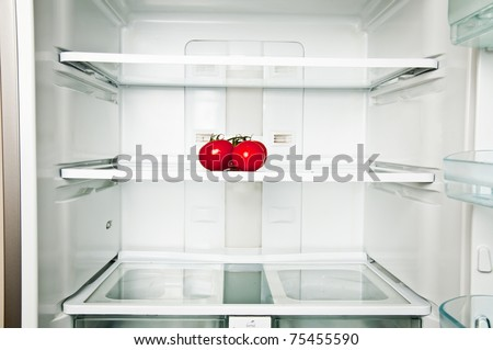 Refrigerator close up with tomatoes - stock photo