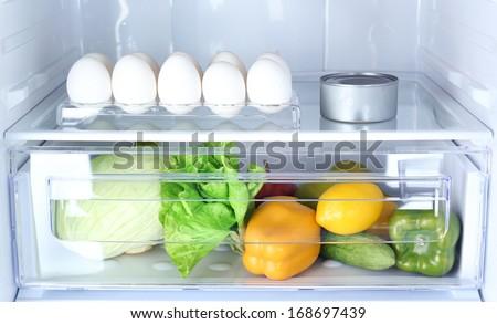 Refrigerator full of food - stock photo