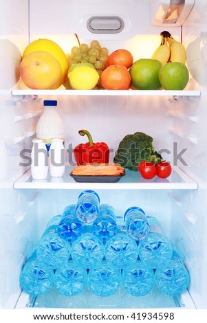 refrigerator full of healthy eating - food and drink - stock photo