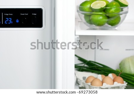 Refrigerator full with some kinds of food - fruits, vegetable and eggs - stock photo