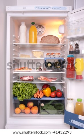 refrigerator full with some kinds of food - vegetables, meat, fish