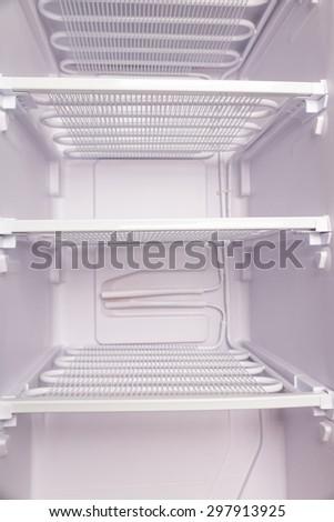 refrigerator inside with shelf - stock photo