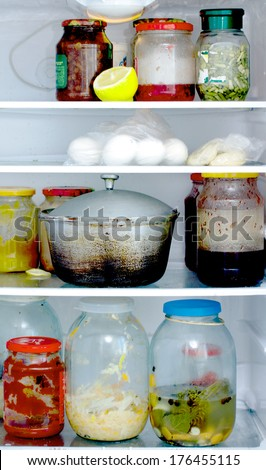 refrigerator with food - stock photo
