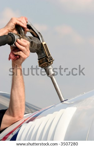 Refuel the plain in close up - stock photo