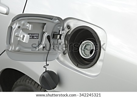 Refueling a car at a fuel station - stock photo