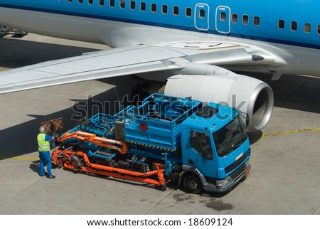 refueling a plane on the airport - stock photo