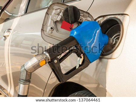 Refueling the car with fuel on a filling station - stock photo