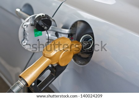 Refueling vehicles in petrol station to the car. - stock photo