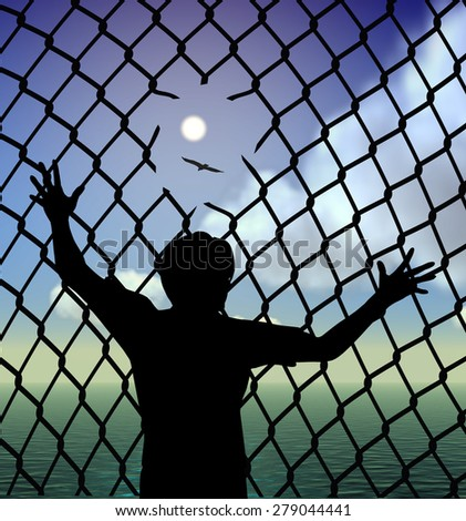 Refugee. Destitute person behind the fence in the refugee camp longing for liberty and peace - stock photo