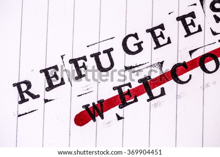 refugees welcome strikethroughtext on white line paper - stock photo