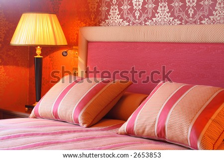 Regal bedroom with comfy pillows and duvet. - stock photo