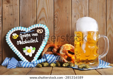 regards from the Oktoberfest - original bavarian gingerbread heart with Oktoberfest beer mug and soft pretzels from Germany  - stock photo