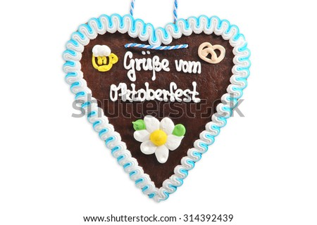 regards from the Oktoberfest - original bavarian Oktoberfest gingerbread heart from Germany on white background